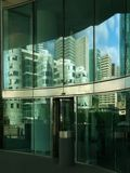 Reflections of the city. Reflections on a glass building Stock Images