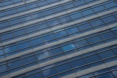 Reflections of clouds in blue glass skyscraper Royalty Free Stock Photography