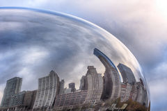 Reflections of clouds and buildings on the Bean. Clouds and buildings reflected of a part of the curved surface of the Bean stock photo