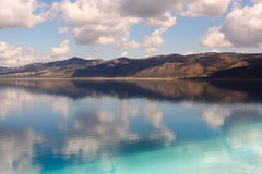 Reflections of clouds and mountain in Lake Salda in Turkey Stock Images
