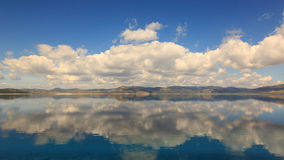 Reflections of clouds and mountain in Lake Salda in Turkey. Lake Salda located in southwest of Anatolia.It is known as the deepest lake of Turkey.And it is very Stock Image