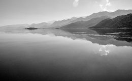 Reflections of the clouds and mountains in a water Royalty Free Stock Photos