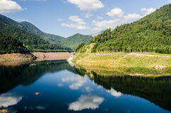 Reflections. Clouds and sky reflected in a mountain lake Stock Photography