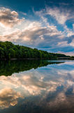 Reflections of clouds and trees at sunset in Lake Marburg, Codor Royalty Free Stock Photography