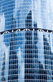 Reflections of clouds in windows of a skyscraper Stock Images