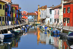 Reflections of colorful houses in Burano stock photography