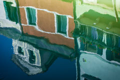 Reflections of colorful houses, Burano, Italy Stock Photo