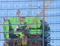 Reflections of construction cranes Stock Photo