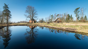 Reflections of country house in the pond Stock Photography