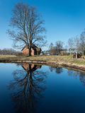 Reflections of country house in the pond Royalty Free Stock Photo