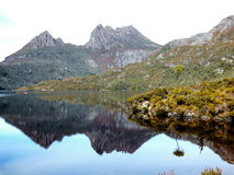 Reflections. Dove Lake in Cradle Mountain, Tasmania reflects into the lake below Stock Photo