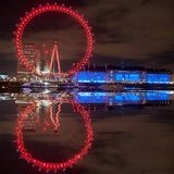 Reflections of the eye. Shot from North bank of Thames of london eye and county hall Stock Images