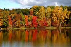 Reflections of Fall. Fall colors reflected in a smooth lake royalty free stock photography