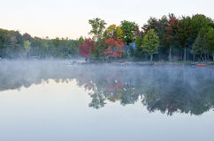 Reflections of Fall Colors on a Tranquil Lake Royalty Free Stock Image