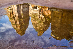 The rains did help create nice reflections... Reflections in flooded yard of Angkor Wat in Siem Reap, Cambodia Stock Images