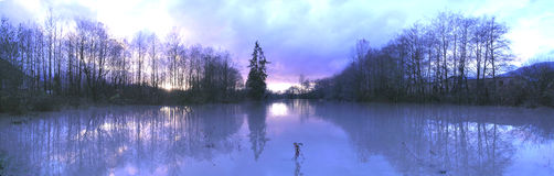 Reflections of Floodwaters - Panorama in Blue. Panorama of wide flood waters, with interesting color Stock Photos