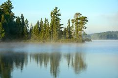 Reflections on a Foggy Wilderness Lake Royalty Free Stock Images
