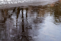 Reflections in frozen lake on sunset Royalty Free Stock Images