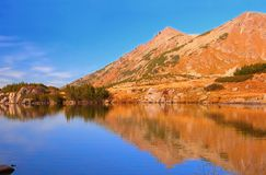Reflections on a glacial lake. In Pirin mountain Royalty Free Stock Photo