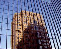 Reflections in Glass. A skyscraper reflecting in another skyscraper royalty free stock image