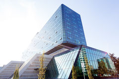 Reflections on glass facade Stock Images