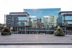 Reflections in the glass front from the town hall in Koksijde.  Stock Images