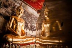 Reflections of a golden Buddha Stock Photos