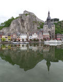 Reflections of gorgeous church and architecture on the Meuse river at Dinant, Belgium. Reflections of gorgeous church and architecture on the Meuse river at Royalty Free Stock Photos