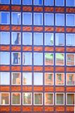 Reflections in hafencity. The reflection of the blue sky and church in the City of Warenhouses Hamburg.Hafencity Royalty Free Stock Image