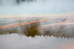 Reflections in the Hot Spring. This picture was taken at the Grand Prismatic Springs at Yellowstone National Park. The waters around the edges of the pool were Royalty Free Stock Images