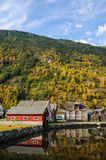 Reflections of houses in the waters of a fjord in. Norway Stock Photography