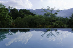 Reflections on the infinity pool Stock Photos