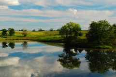 Reflections on an Iowa Farm Pond Royalty Free Stock Images