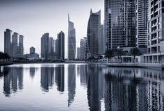 Reflections of Jumeirah lakes towers at dusk, Dubai, United Arab Royalty Free Stock Photo