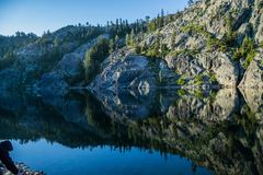 Reflections on Kangaroo Lake. An early morning photo of Kangaroo Lake in Northern California. The glassy water creates a mirror image of the rock formations Stock Photos