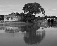 Reflections in the Kennet and Avon Canal. Buildings and trees are reflected in the Kennet and Avon Canal royalty free stock photos