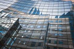 Reflections of La Defense. Reflection of office buildings on the glass of one of the buildings in the business center of La Defense. Paris. France Stock Image