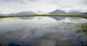 Reflections on the lagoon in Iceland Royalty Free Stock Image