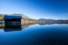 Reflections in the lake. Clear blue morning at lake Walchensee in Bavaria Stock Photography