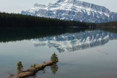 Reflections. Lake with mountain reflection and small island Stock Photography