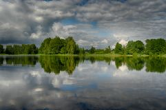 Reflections in a lake with sky and trees. Latvia summer travel in Vidzeme lakes landscapes Royalty Free Stock Photo