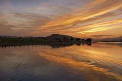 Reflections on the lake at sunset Stock Photography
