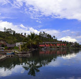 Reflections of Lake Toba. Royalty Free Stock Photo