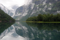 Reflections in Lovatnet lake, Norway Royalty Free Stock Images