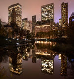 Reflections of Manhattan in Central Park pond at night Royalty Free Stock Photography