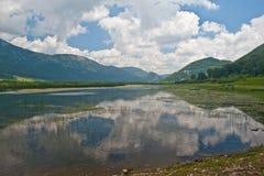 Reflections on Matese lake Stock Images