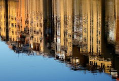 Reflections. Medieval houses reflection on Arno River surface stock photos