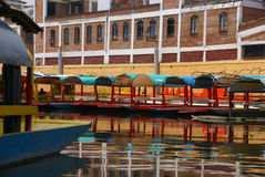 Reflections of moored colored boats Stock Photography
