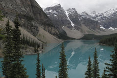 Reflections in Moraine Lake in Canadian Rockies Stock Images