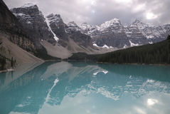 Reflections in Moraine Lake in Canadian Rockies Stock Photography